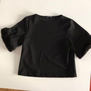 Zara black crepe knit  top with fur trim.
